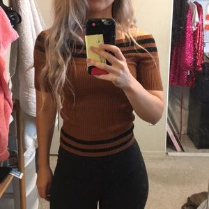 Slightly cropped of shoulder top in brown